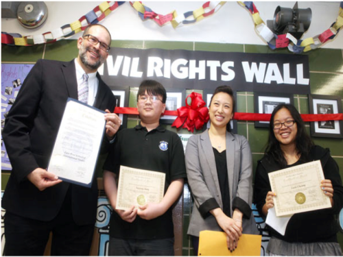 Students Yuxiong Jiang (second l.) and Lorin Cheung (r.) are presented with certificates by Yuh-Line Niou from state Assemblyman Ron Kim's office. They are joined by Principal Ben Sherman (l.). Photo by Christina Santucci
