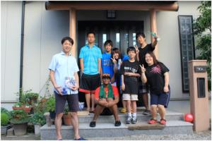 Douglas with Anthony, Junda and Host Family
