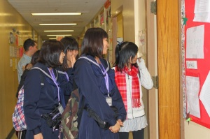 Quilin Li leads a tour of our school