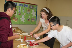 Mrs. Gorry leading a Cookie Decorating station