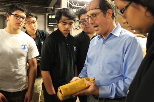 Mr. White explains the vacuum sealed technology in their packaging.