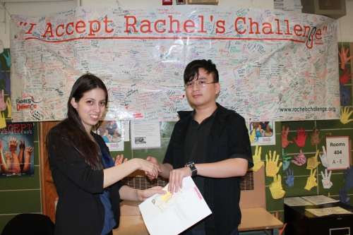 Our English teacher, Ms. Binaso, presents Yu Xiong with a congratulations letter from Scholastic Scope Magazine and a Visa gift card!
