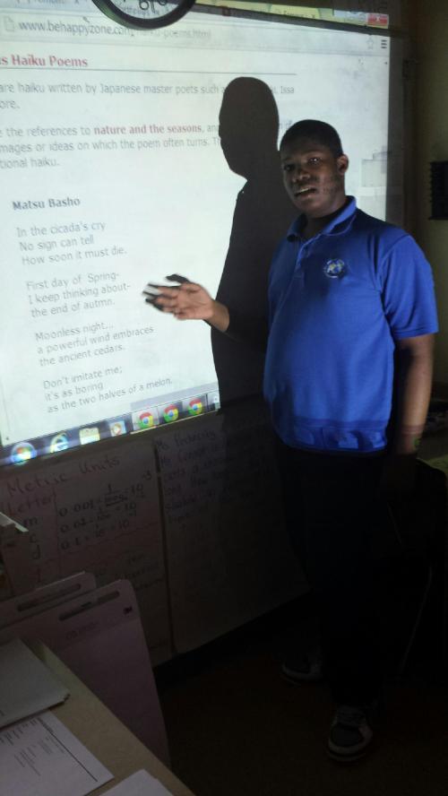 Tayvon reads a Japanese haiku poem in English translation