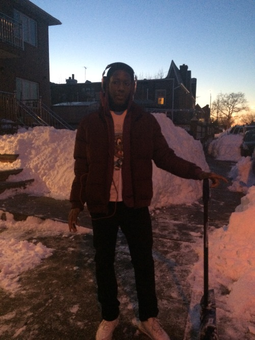 Omar Lawson taking a break after helping a UPS truck that got stuck in the snow.