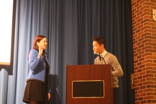 Student Body President, Corey Cheung, symbolically installs Assemblywoman Rozic to her third term in office.